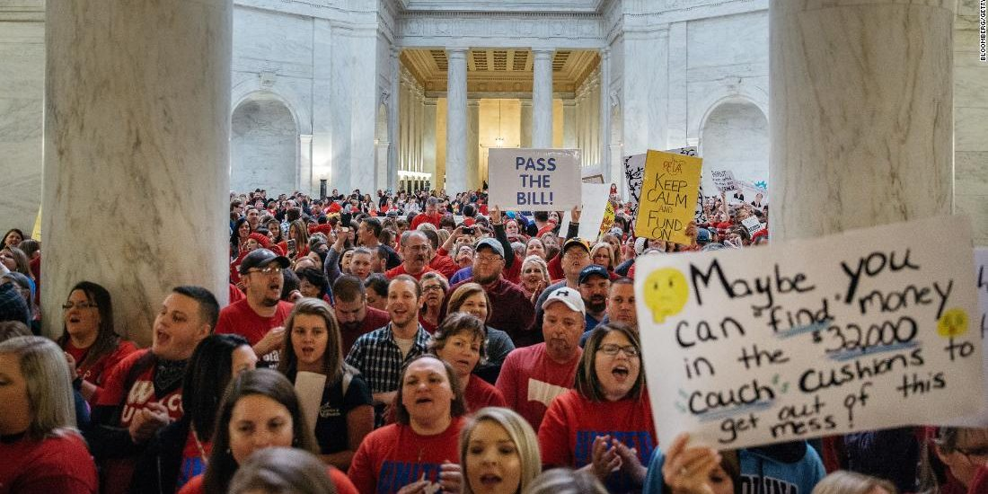 West Virginia governor signs bill to give striking teachers pay